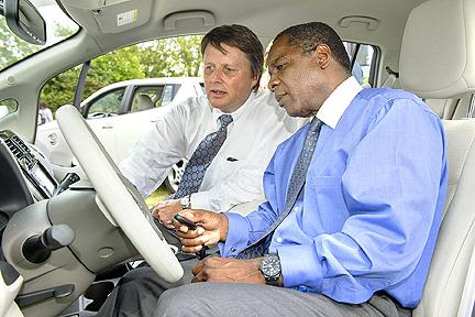 Kevin Martin, director of Nissan Parts Quality Engineering, shows MTSU President Sidney A. McPhee the interior of a new Nissan LEAF electric car donated to the university Aug. 28.