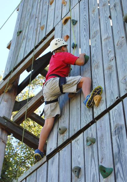 A mid-state teen enjoying a climbing activity at a grief counseling session held in La Vergne by Alive Hospice.