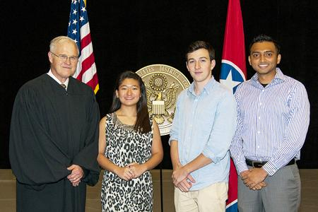 Judge Joe B. Brown, left, poses for a photo with three MTSU students who became U.S. citizens in a special Sept. 17 naturalization ceremony. The students are Tammy Li, Levon Mkrtchyan and Mike Patel.