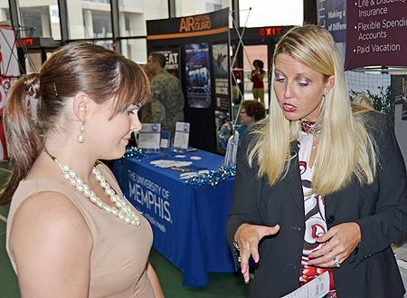 MTSU senior Sydney Burfitt, left, a liberal studies major who'€™ll graduate in December, speaks to Lori Hagins, a store manager with Shane Co. in Cool Springs, during the Fall Career Fair inside Murphy Center Oct. 10.