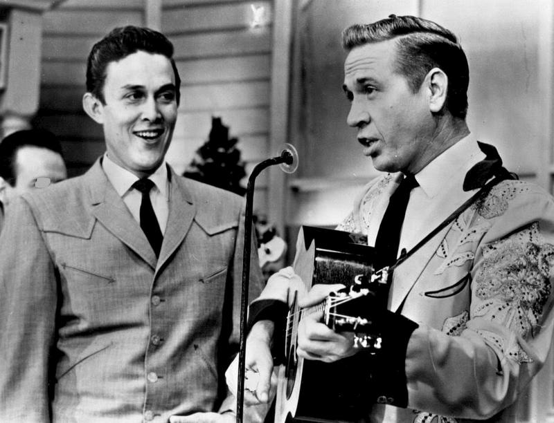 Jimmy Dean (L) welcomes Buck Owens, one of 35 future Country Music Hall of Famers who performed on his prime time ABC variety show between 1963 and 1966.