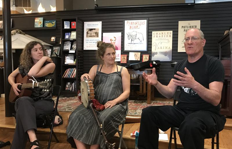 Author Daniel Wolff (R) speaks about his book on Bob Dylan and Woody Guthrie at Parnassus Books, while Rayna Gellert (L), Abigail Washburn and Robyn Hitchcock (not pictured) provided the music.