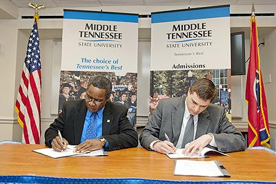"MTSU President Dr. Sidney McPhee, left, and Travis Kraft, acting director of the Veterans' Affairs Nashville Regional Office, sign an agreement between MTSU and the U.S. Department of Veterans Affairs naming MTSU a ""VetSuccess"" University on March 13."