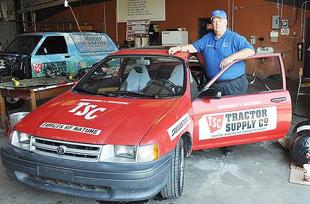Dr. Cliff Ricketts stands next to the specially adapted 1994 Toyota Tercel that is part of his alternative-fuels fleet of vehicles for a cross-country spring break trip. (MTSU file photo)