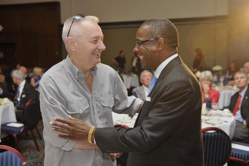 "MTSU alumnus Andrew Woodfin ""Woody"" Miller (B.S. '66), left, greets President Sidney A. McPhee at the University's Philanthropy Luncheon in the James Union Building April 13."