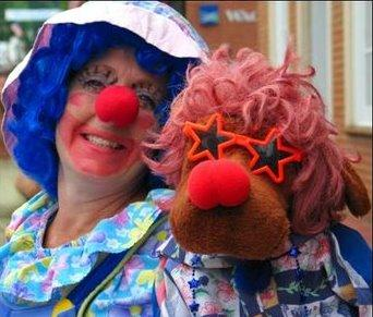 Kelly Harris as K.C. The Clown (with Dee-Oh-Gee)