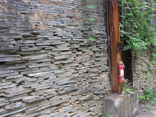 "Century-old stacked soapstone wall that still stands in ""downtown"" Schuyler."