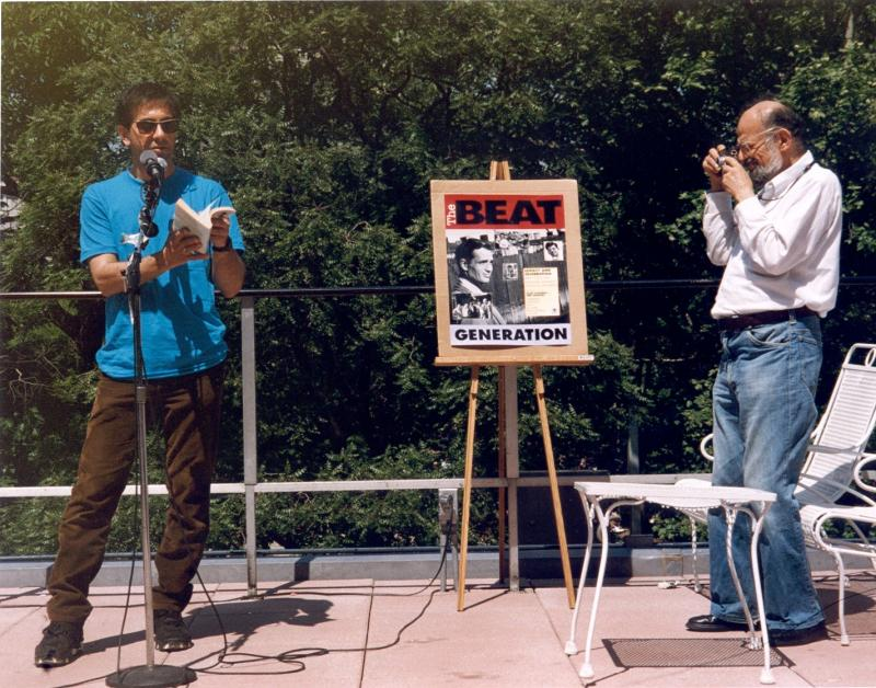 Lee Ranaldo from Sonic Youth reads from Ginsberg's Howl at a Beat poetry event while Ginsberg takes a snapshot. Photo by Gordon Ball.