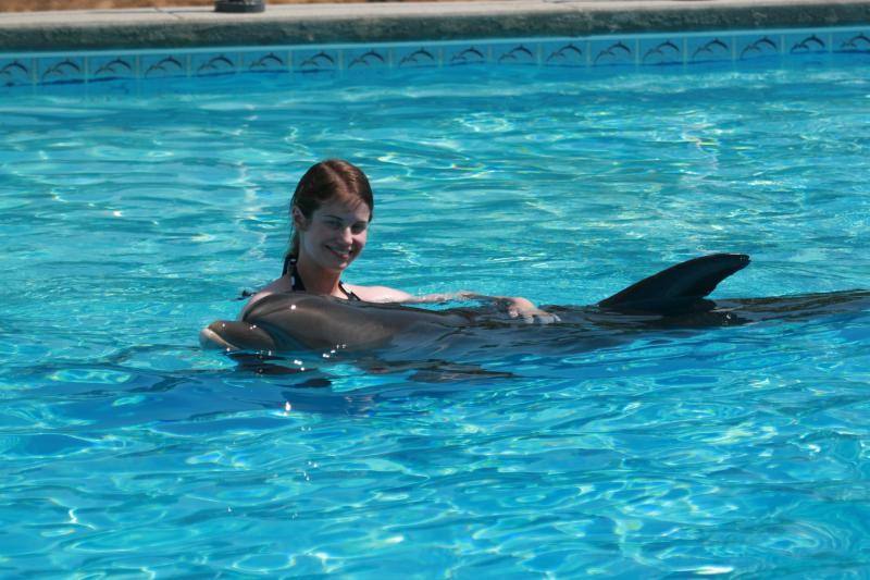 Katy Homles with a baby dolphin