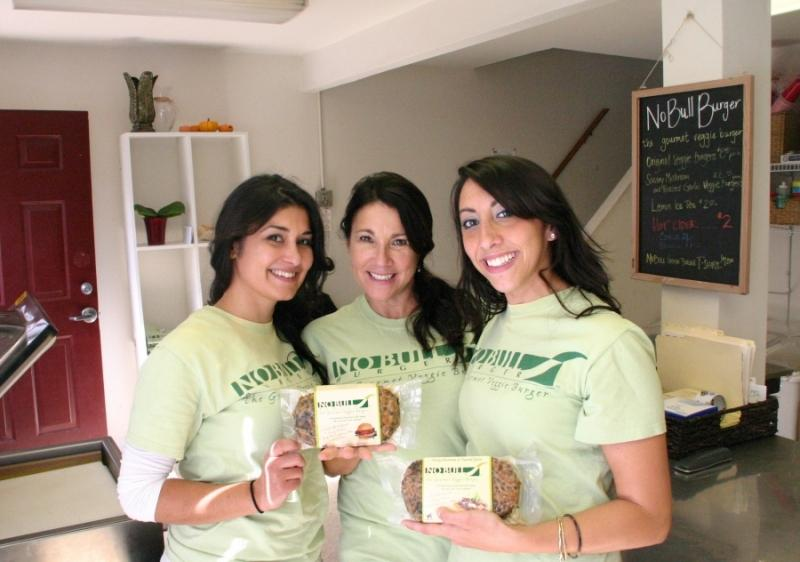 Crissanne Raymond (center), and her daughters Heather and Elizabeth, founders of No Bull Burger. Photo credit:  Dave McNair of The Hook