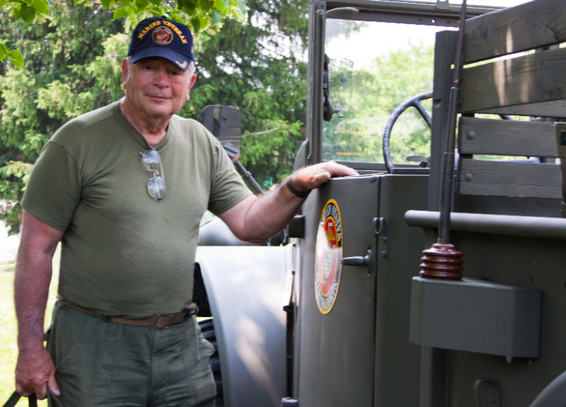 Neil Conner of Woodstock with a restored Marines truck