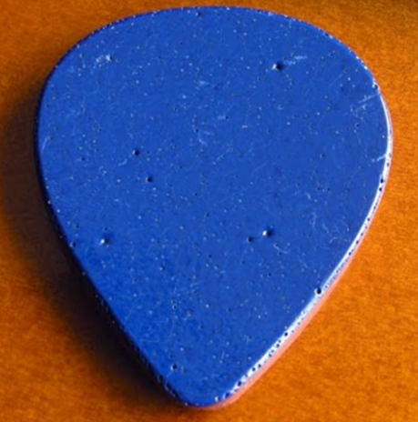 Guitar pick made from one of the distinctive blue roof tiles of the gas station in whose parking lot Hank was declared dead: the now-demolished Burdette's Pure Oil in Oak Hill, WV (Charles A. Slott Collection).