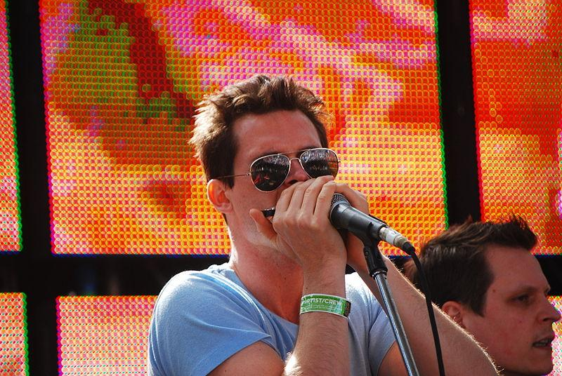 Ketch Secor blows harmonica in an Old Crow Medicine Show performnce  at Australia's Golden Plains Festival. Photo credit: Flickr user Ashton (miss.libertine) via Wikipedia Commons.