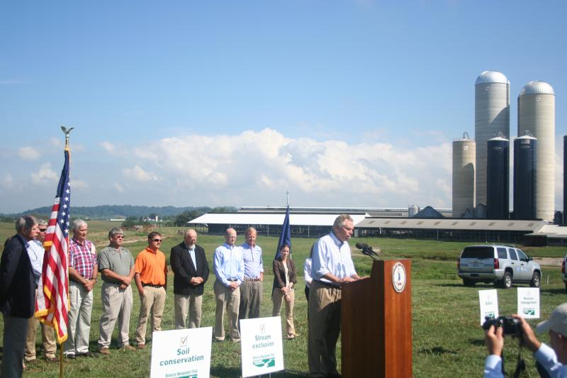 Governor Terry McAuliffe discusses the significance of the Resource Management Plan program, with Gerald Garber's Cave View Farms as a backdrop. Garber's farm is one of the first two in the state to develop a resource management plan.