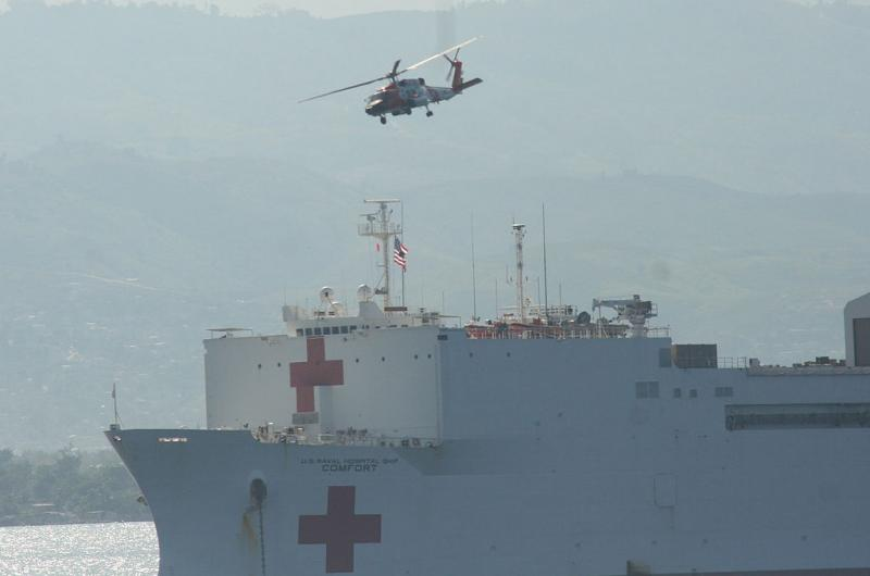 Coast Guard helicopter and US Navy hospital ship responding in January, 2010