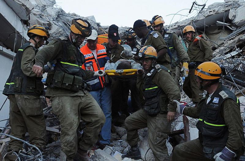An IDF team rescues a worker who had been trapped in a collapsed government building.