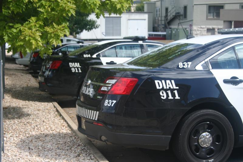 Law enforcement agencies, like the Harrisonburg Police Department whose vehicles fill a parking lot downtown, represent the most visible aspect of the local corrections system.