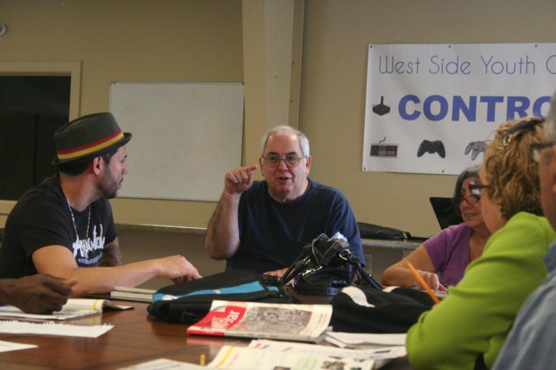 Raul Jorrin (center), teaches English classes through Skyline Literacy, a Harrisonburg nonprofit.