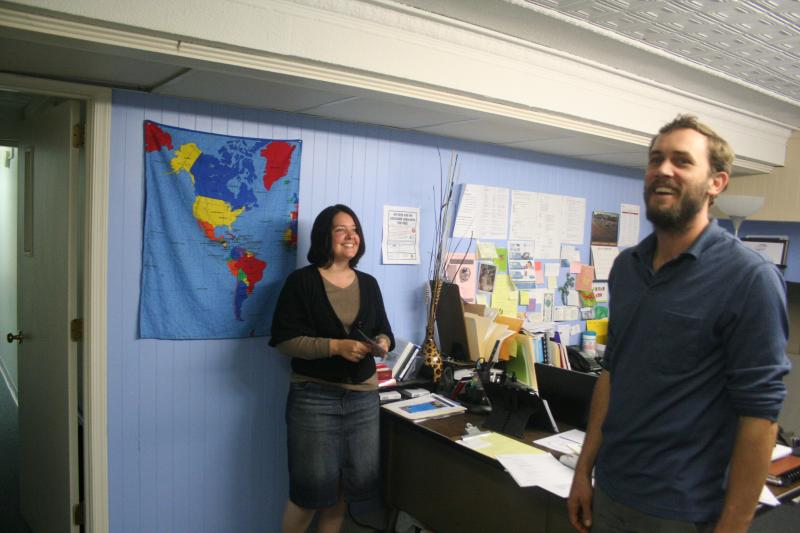 Alicia Horst, executive director of NewBridges Immigrant Resource Center, chats with her colleague, Jamie Miller, in their downtown Harrisonburg office.