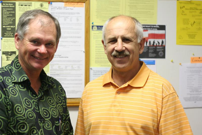 Jim Hershberger (left) is program coordinator for the Harrisonburg Refugee Resettlement Office, run by Church World Service. Viktor Sokluyk, who came to the United States as a refugee from Ukraine in 1990, oversees immigration services in the same office.
