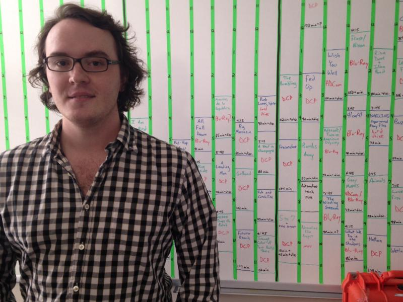 Wesley Harris, programmer and operations manager for the Virginia Film Festival, works year-round to book and schedule the four-day festival program that's blocked out on a whiteboard in his office.