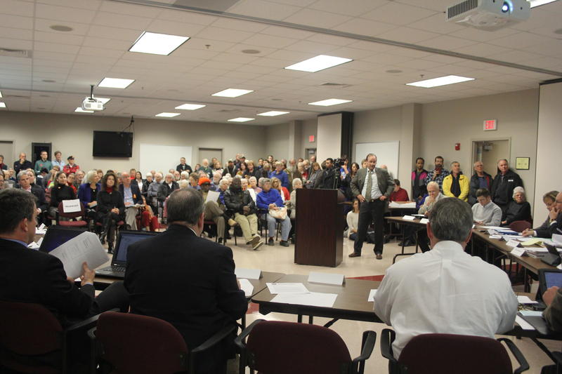 Mike Jones (center right, beside podium) of Moseley Architects presents a community-based corrections plan at a crowded meeting of the Harrisonburg-Rockingham Community Criminal Justice Board last week. Moseley Architects was hired to study new plans.