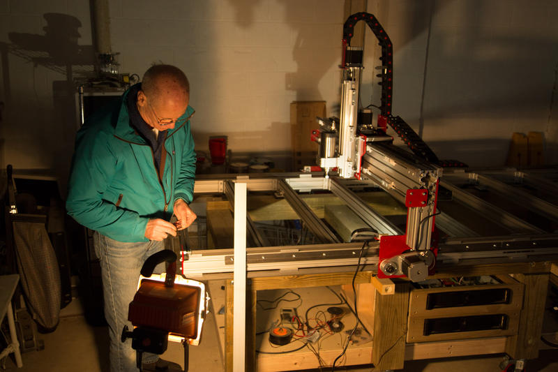 Doug Owens at Tinkersmiths works on a computer numeric control machine which can be used to make furniture and architectural elements, among other things.