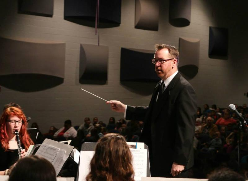 Fine Arts Director J.R. Snow conducts a performance at Harrisonburg High School