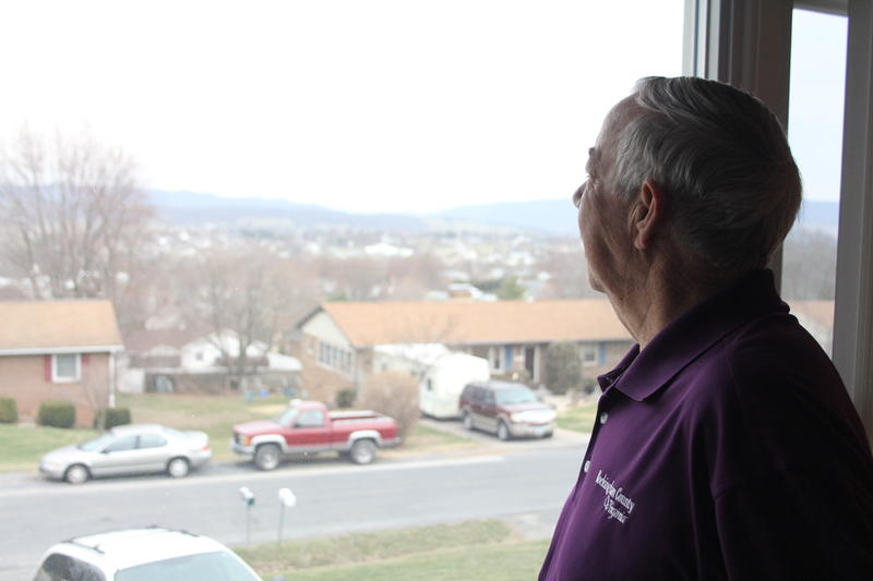 Rockingham County Supervisor Pablo Cuevas looks west out the window of his living room in Broadway, toward the ridges that surround Bergton.