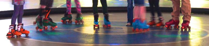 Skate-clad feet on the rink at Stonebridge Skate Center in Natural Bridge Station.