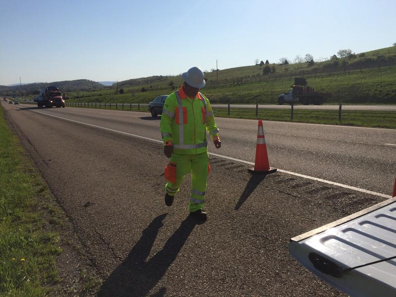 Safety Cones go out at the scene of a stranded vehicle on Interstate 81 near Harrisonburg.