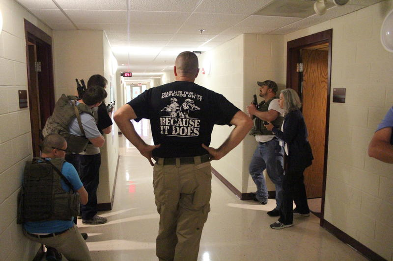 Harrisonburg Police Captain Tom Hoover (center), oversees an active shooter drill with students in Harrisonburg's 2015 Citizen Police Academy.