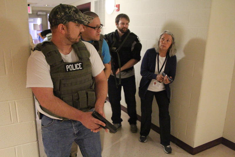 Participants in the Citizen Police Academy during an active shooter drill. (L to R): Jon Robertson, Wallace Cedeño, Tyler Sweet and Terry Claxton.