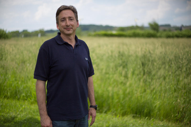 Gary Flory stands in front of a field near a regional office of the Virginia Department of Environmental Quality. He is the Agricultural Programs and Stormwater Compliance Manager for that office.