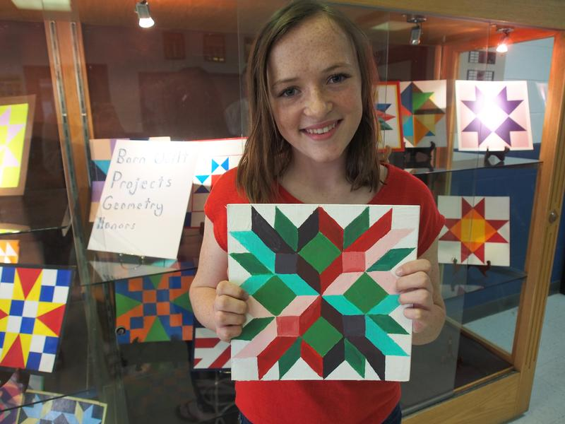 Advanced placement geometry student, freshman Sophia Youngdahl, shows off her barn quilt design.