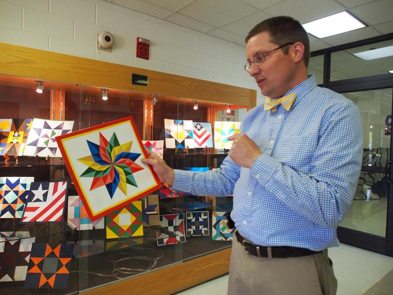 Rockingham County High School math teacher Scott Fleshman shows off a particularly advanced barn quilt design from one of his honors students.