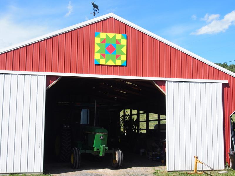 Most of the outbuildings at Russell Fleshman's farm in Rockbridge County are accessorized with his geometry-heavy barn quilts.