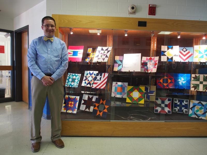 Honors geometry students' intricate barn quilt designs are displayed in the front lobby of Rockbridge County High School.
