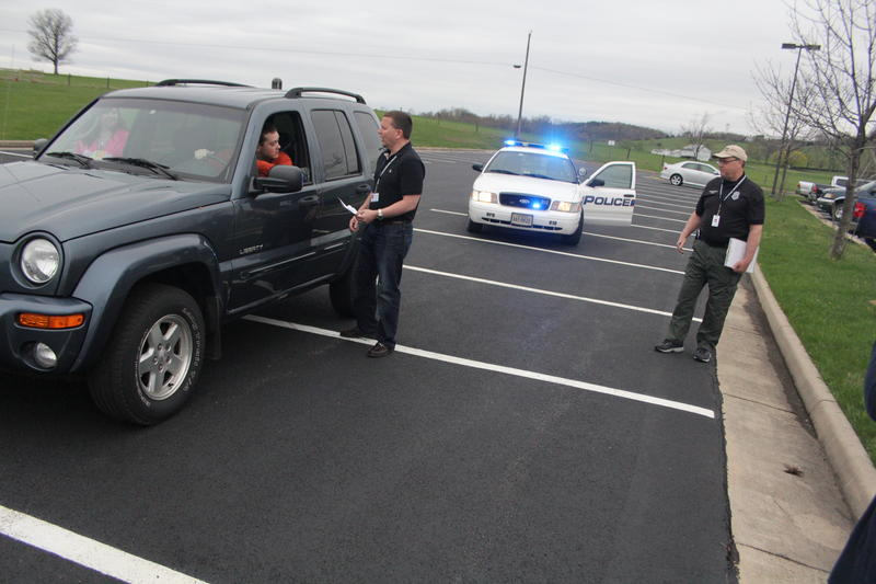 Mike Busing (center) practices a traffic stop, as Officer Scott Sellers of the Harrisonburg Police Department looks on.