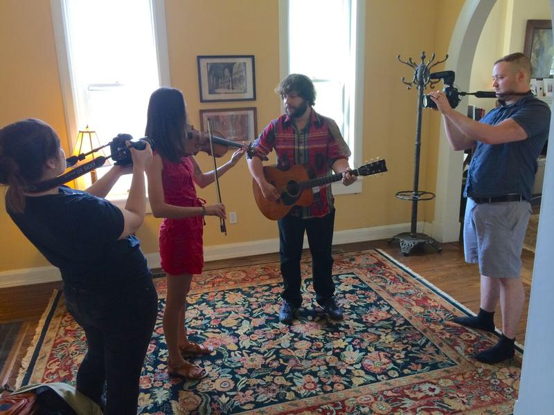 """Zaynah and Forrest film while Brad Lauretti and Sadie Frederick of This Frontier Needs Heroes perform their song """"No More War."""""""
