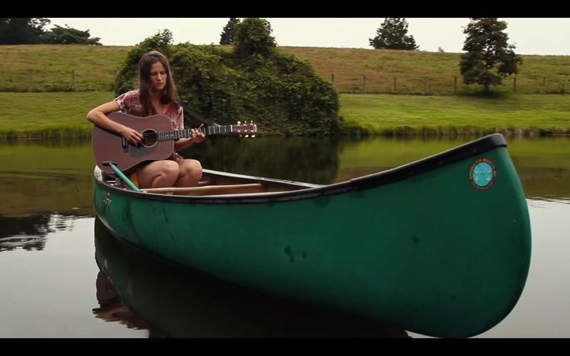 """For her Garage Video Session, Charlottesville singer/songwriter Devon Sproule performed her song """"Say It Again"""" while floating in a canoe."""