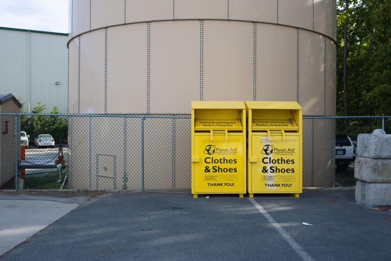 "A bin for old clothes and shoes, which Van der Linde cannot recycle. ""The best recycling is reusing,"" said Andrea Johnson, sales manager for Van der Linde as she explained that when people put clothes in the trash they go automatically to the landfill."