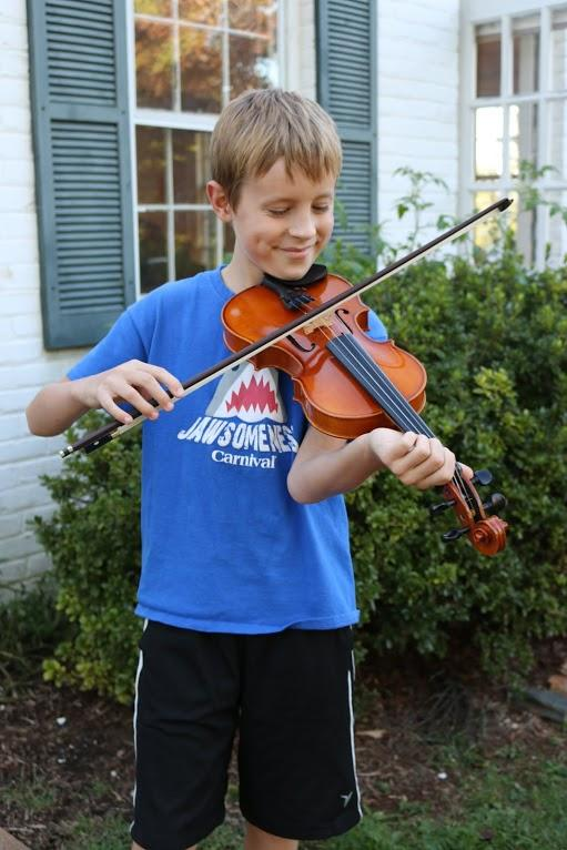 "Eleven-year old Will Tilman takes fiddle classes at the Front Porch and says, ""It's very entertaining."""