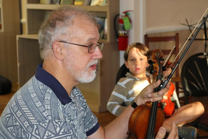 Musician Pete Vigour leads the Intermediate Fiddle class at The Front Porch. Vigour teaches group and private lessons two days a week.