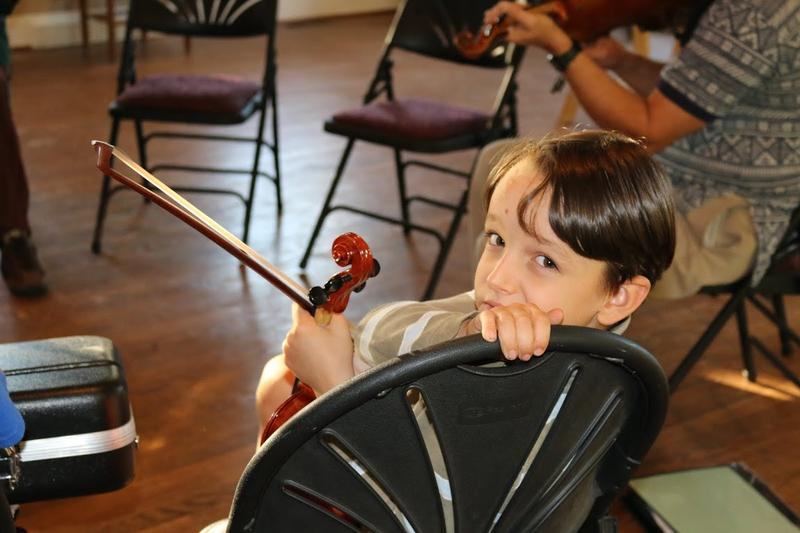 Seven-year old Pachee Bonham had a private fiddle lesson, then hung out afterwards to join the group fiddle class.