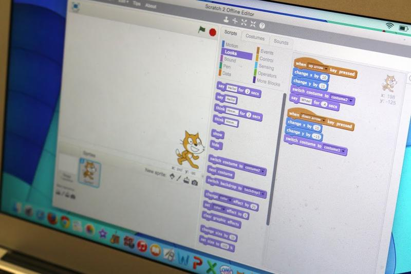Girls' Geek Day participants get introduced to coding through a simple drag-and-drop program called Scratch.