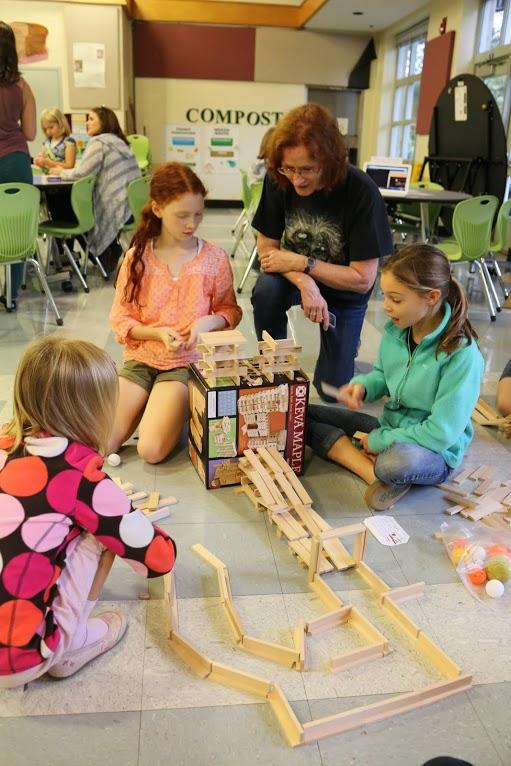 Jennifer Whitenack, a gifted resource teacher at Baker Butler Elementary, leads the Keva Plank Challenge. The gender-neutral blocks are a perennial favorite at Girls' Geek Days.