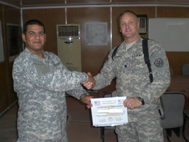 Tony Razul, a former translator for the U.S. military in Iraq, receives a certificate of appreciation for professionalism and dedication.