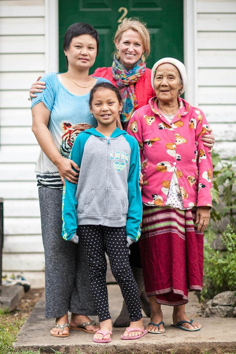 International Neighbors founder and executive director Kari Miller with a local Karen refugee family who spent 11 years in a refugee camp in Thailand.