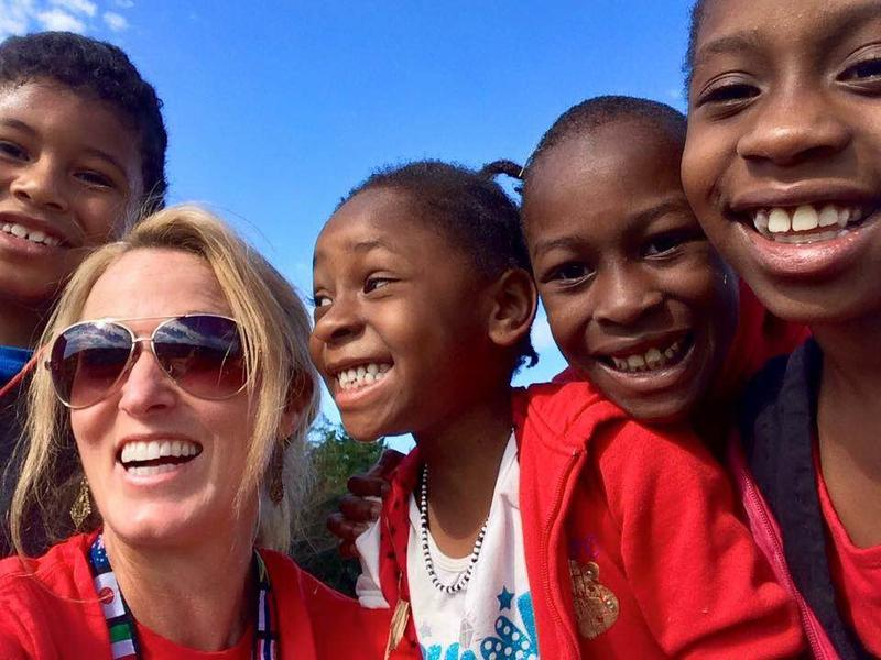 Kari Miller, the executive director and founder of International Neighbors, is pictured here with a group of refugee children from Somalia.
